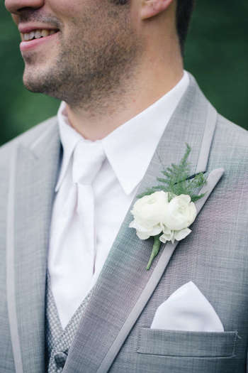 Groom in a light grey suit with