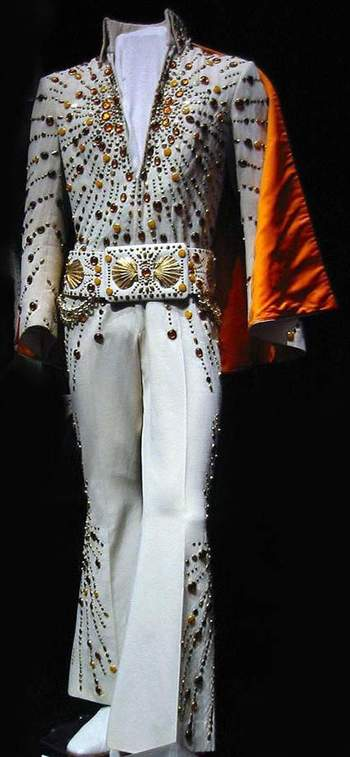 The orange target suit is today in display at Graceland , with the cape and the original belt.