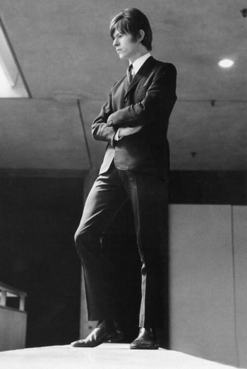 A brooding sharp suited David Bowie in