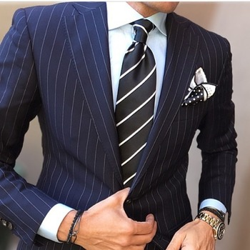 Navy pin striped suit, striped tie, white