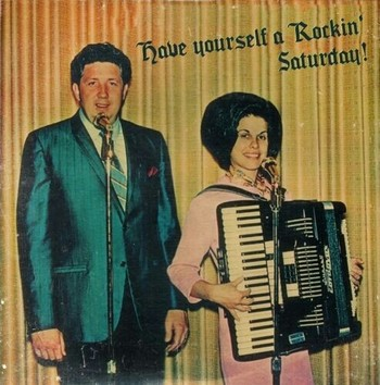 Have Yourself A Rockin' Saturday with a green suit, big hair, and an accordion.