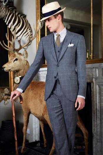 A very elegant cool grey lightweight wool three-piece by Hackett. The cut-away jacket skirt works wel