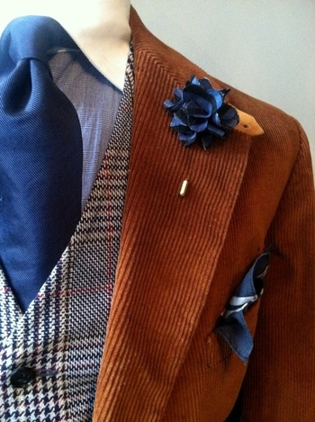 Love the whole ensemble but the blue tie, lapel pin and pocket square really pull it together.