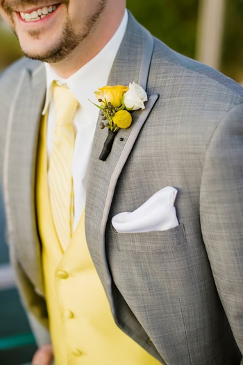Groomsmen outfits. Grey pants and possibly suit jackets. Vests and ties in turquoise instead of yello