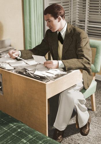 Jimmy Stewart reading his fan mail, 1940