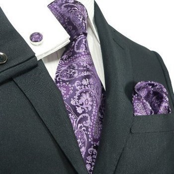 Bold purple paisley tie on white shirt and dark suit works for me