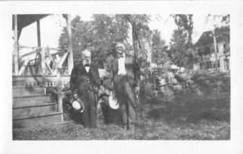 Photograph Snapshot Vintage Black and White: 2 Elderly Men Suits Yard 1920's
