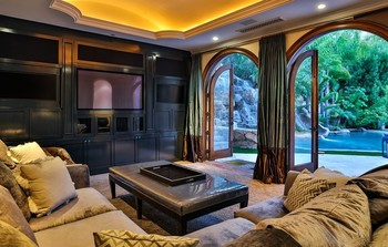 Magnificent Mediterranean estate boasting outdoor tropical oasis