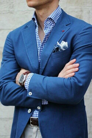 Mens street style fashion: blue blazer jacket, beige pants chinos, brown leather watch, brown leather