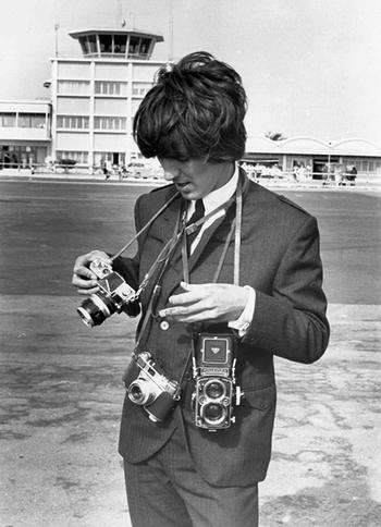 Celebrities with film cameras.