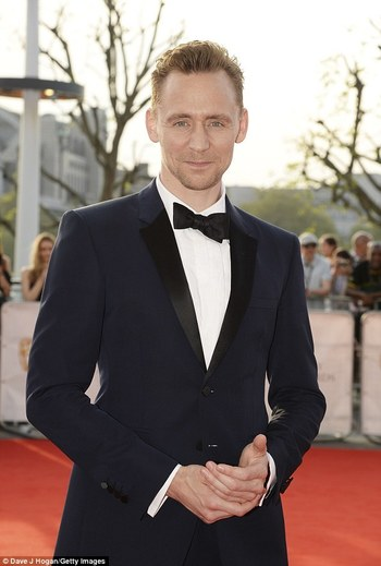 Tom Hiddleston smoulders in navy tux as he leads male style at BAFTAS