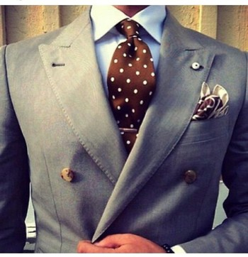 Light grey double-breasted jacket, light blue shirt, brown tie with white polka dots