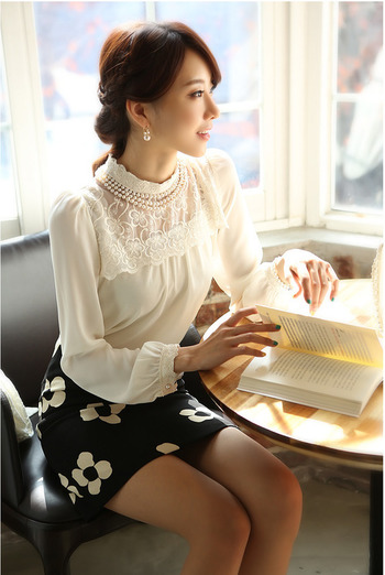 A cute skirt and a super feminine top. With fashion equality in the workplace, both men and women can