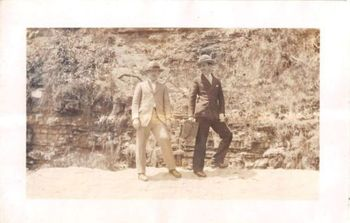 Photograph Snapshot Vintage Black and White: 2 Men Suits Hat Rock Wall 1920's