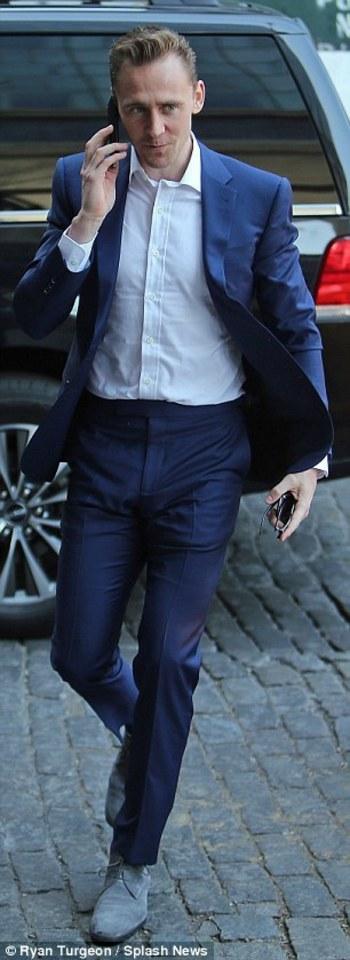 Tom Hiddleston looks razor sharp in a navy suit in NYC
