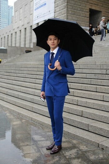 Suited man with an umbrella