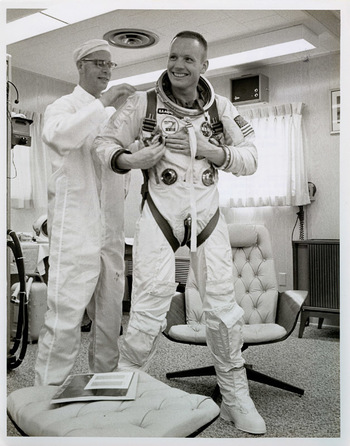 Neil Armstrong getting suited up for his